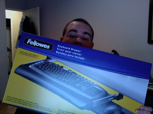 Me holding a new keyboard tray